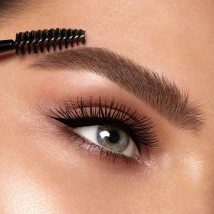 Close up image of brows being brushed