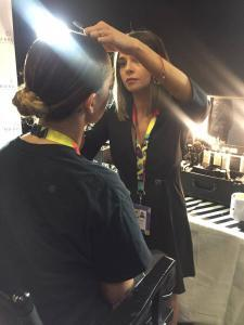 HD Brows stylist Poppy working backstage at the MTV EMAs