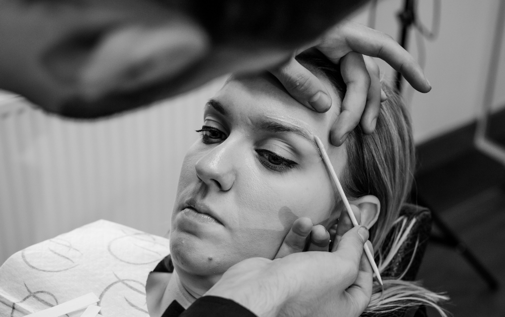 Stylist applying wax to client during HD Brows treatment