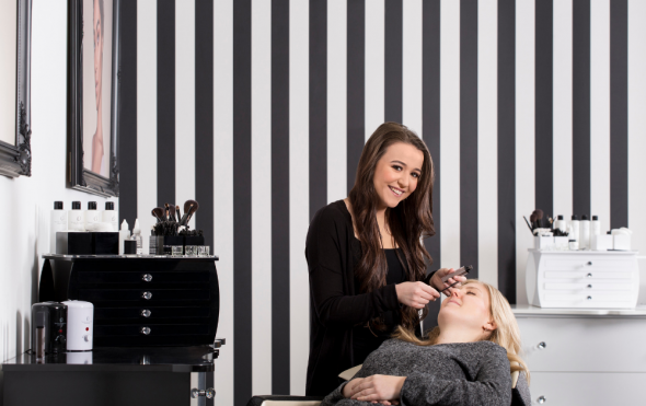 HD Brows stylist performing a treatment on a client