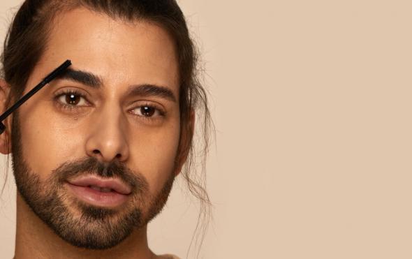 Close up of male model applying eyebrow gel