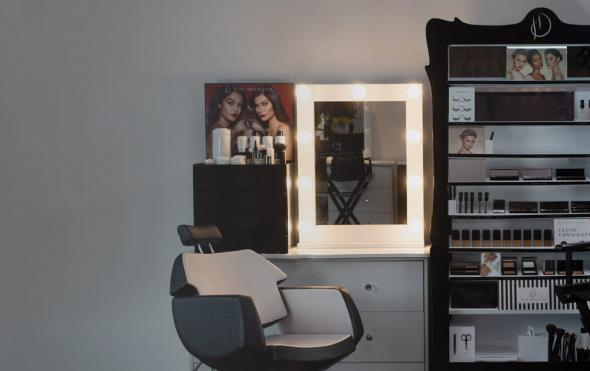 Image of salon brow station with HD Brows workstation, make up stand, chair and illuminated mirror