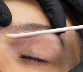 Waxing during eyebrow shaping treatment