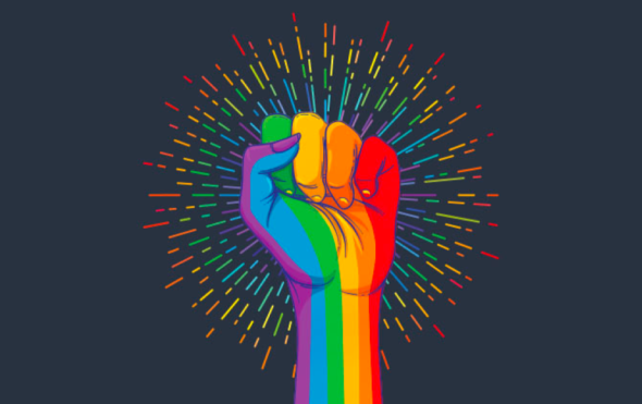 Power fist in rainbow colours to show support for pride month